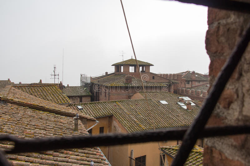 View from facciatone on tiled roofs of Siena. Tuscany. Italy. royalty free stock photo