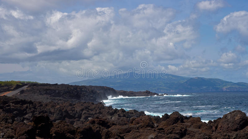 View on the Faial island from the Pico island coast stock images