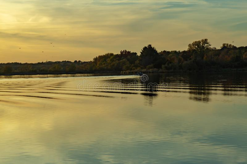Fall colors in a park with reflections in the lake in Omaha Nebraska. View of fall colors in a park at sunset with reflections in the lake in Omaha Nebraska stock photo