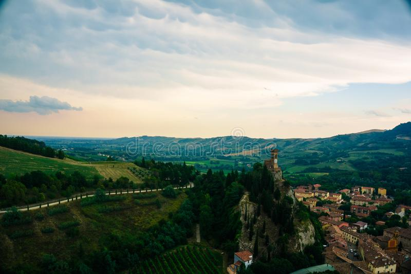 Brisighella, Italy 21 July 2018: The famous tower clock of Brisighella and the countryside stock photo