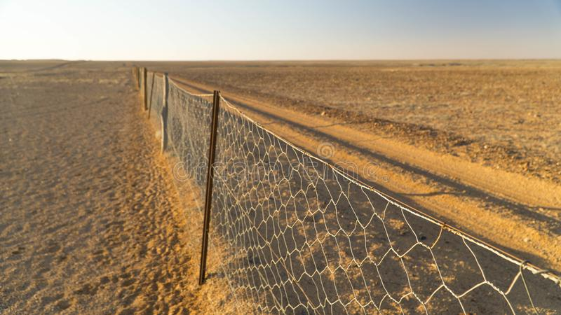 View of famous Dog fence the longest fence in the world  in Kanku-Breakaways Conservation Park near Coober Pedy, Australia. View of famous Dog fence the longest royalty free stock photos