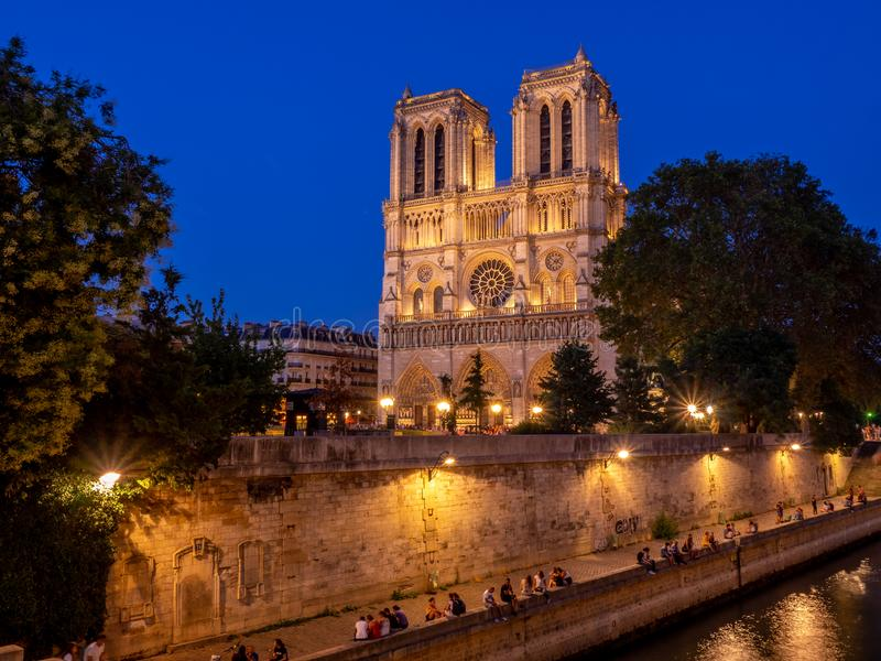 View of the famous Notre Dame Cathedral at night stock image