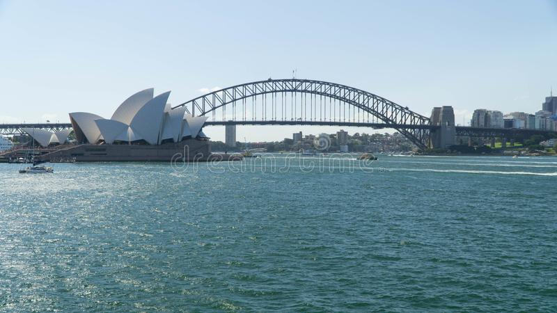 View of the famous Sydney Opera House and the Harbour Bridge seen from Royal Botanical gardens, Australia royalty free stock image