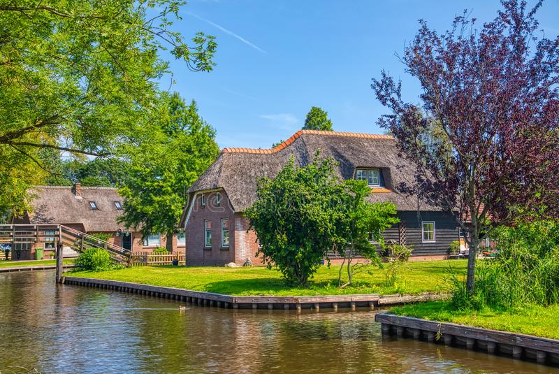 View of famous village Giethoorn with canals in the Netherland. Giethoorn, Netherlands - July 4, 2018: view of famous village Giethoorn with canals in the royalty free stock image