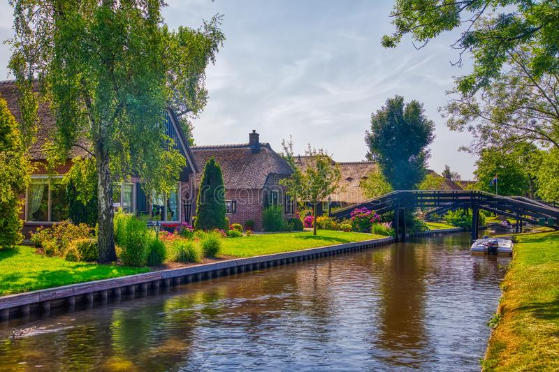 View of famous village Giethoorn with canals in the Netherland. Giethoorn, Netherlands - July 4, 2018: view of famous village Giethoorn with canals in the stock photos