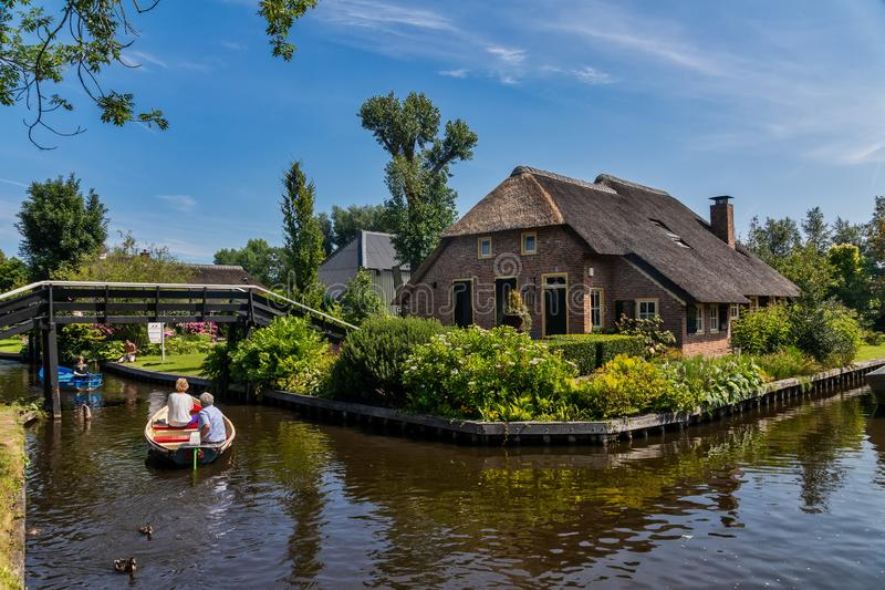 View of famous village Giethoorn with canals in the Netherland. Giethoorn, Netherlands - July 4, 2018: view of famous village Giethoorn with canals in the royalty free stock photography