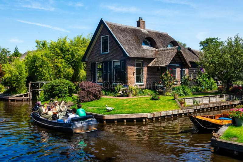 View of famous village Giethoorn with canals in the Netherland. Giethoorn, Netherlands - July 4, 2018: view of famous village Giethoorn with canals in the stock photography