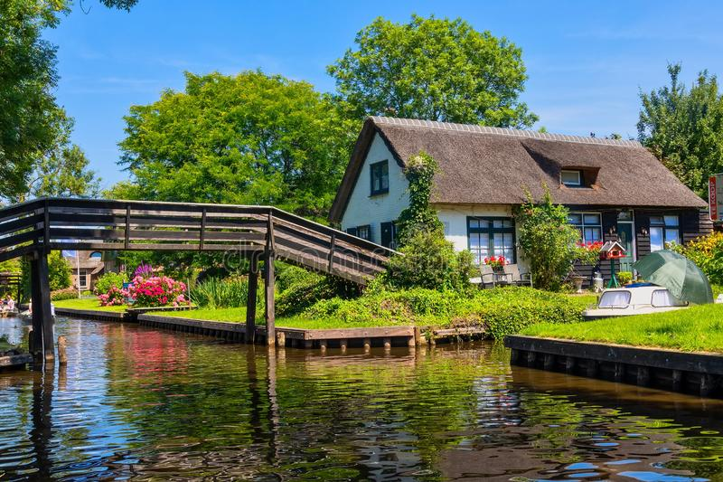 View of famous village Giethoorn with canals in the Netherland. Giethoorn, Netherlands - July 4, 2018: view of famous village Giethoorn with canals in the stock photo