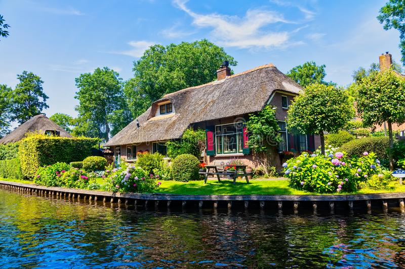 View of famous village Giethoorn with canals in the Netherland. Giethoorn, Netherlands - July 4, 2018: view of famous village Giethoorn with canals in the royalty free stock photos
