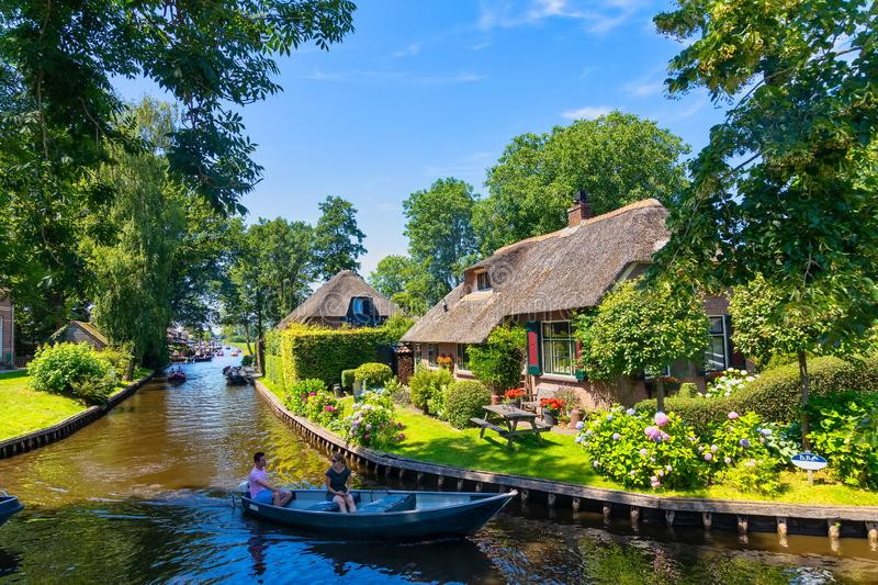 View of famous village Giethoorn with canals in the Netherland. Giethoorn, Netherlands - July 4, 2018: view of famous village Giethoorn with canals in the royalty free stock images