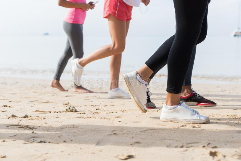 View Of Feet Running On Beach Together Closeup Of Sport People Runners Jogging Working Out Team Training Together. On Seaside stock images