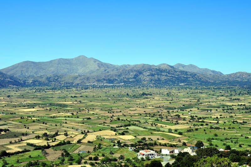 View of the fertile Lassithi Plateau in Crete. Panoramic view of the Lassithi Plateau in Crete, Greece stock photo