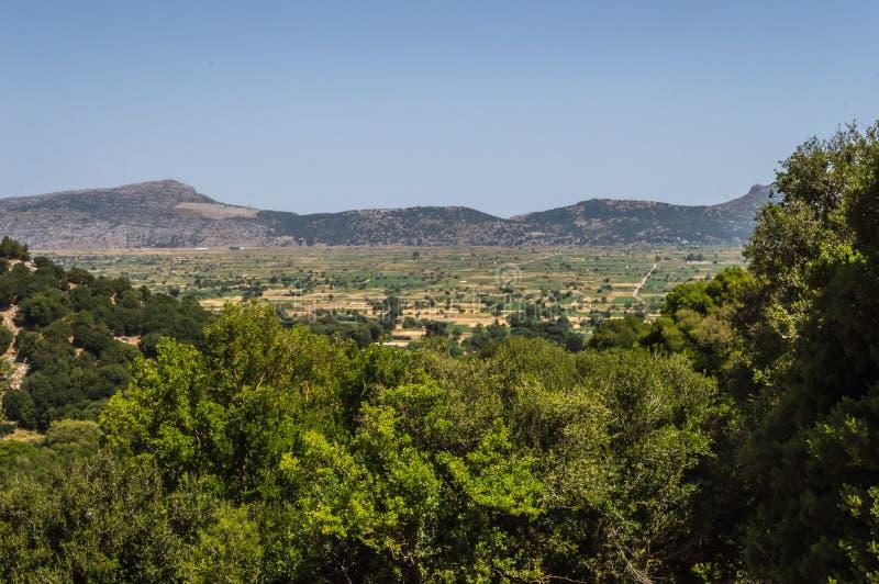 View of the fertile Lassithi Plateau in Crete. Panoramic view of the Lassithi Plateau in Crete, Greece stock photos