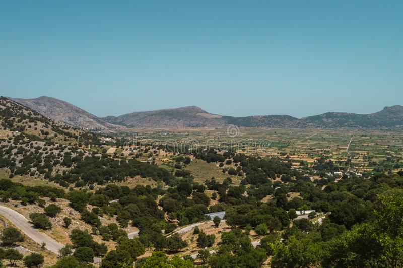 View of the fertile Lassithi Plateau in Crete. Panoramic view of the Lassithi Plateau in Crete, Greece stock images