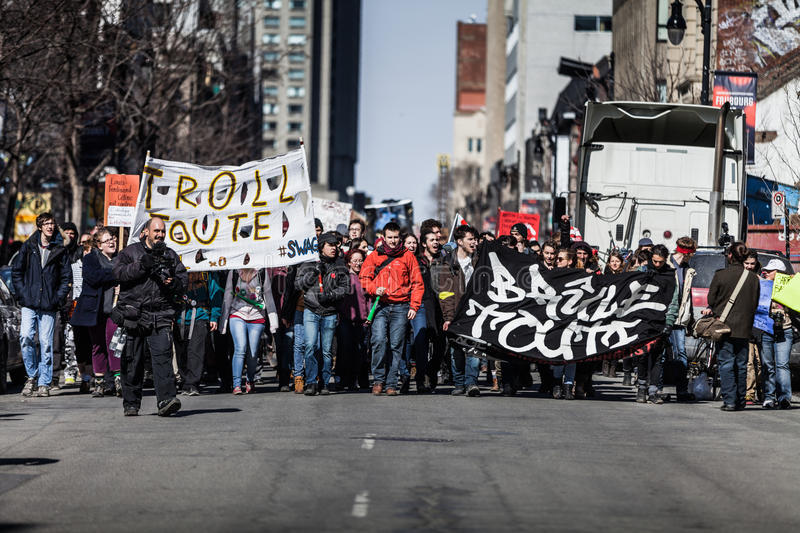 View of the First line of Protesters walking in the Street. MONTREAL, CANADA, APRIL 02 2015. Riot in the Montreal Streets to counter the Economic Austerity royalty free stock photo