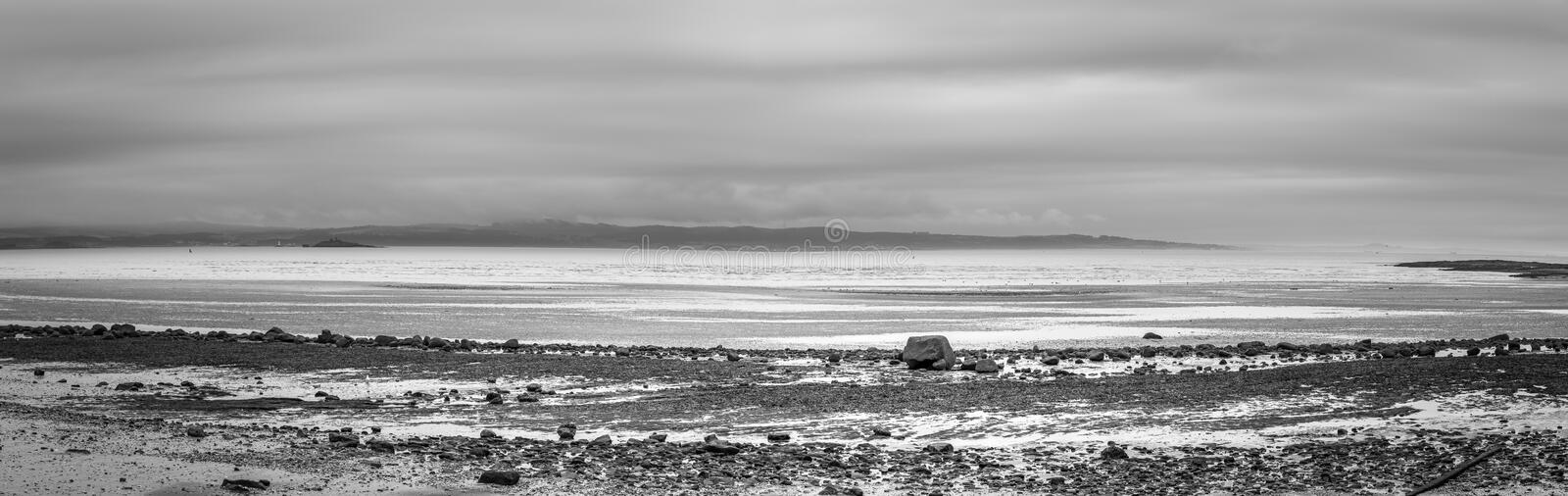 A view of firth estuary and the sea from the Cramond to Grant Harbour coastal footpath royalty free stock photo