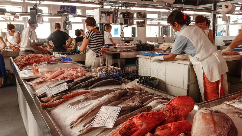 May 10 2019 - View of the fish market in Ciutadella de Menorca, with various colorful fish for sale, price tags in the foreground royalty free stock photos