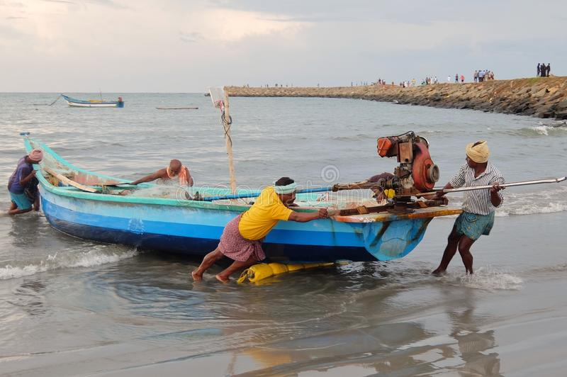 View of a fishermen with fishing boats in Kanyakumari. royalty free stock images