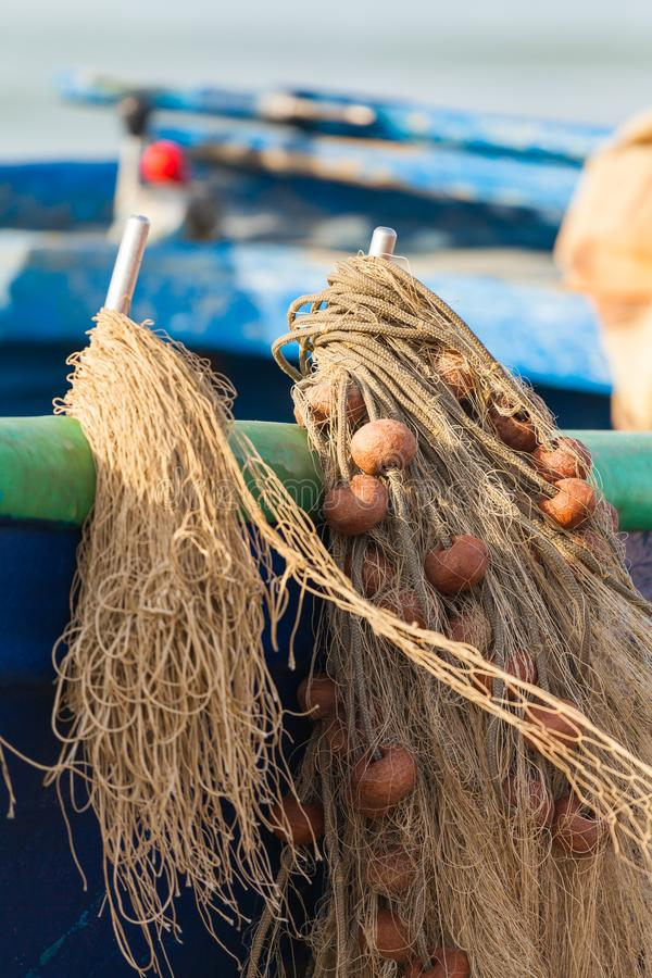 A view of a fishing net in front of the boat on the beach. Beautiful calm sea and water during an hot summer day stock images