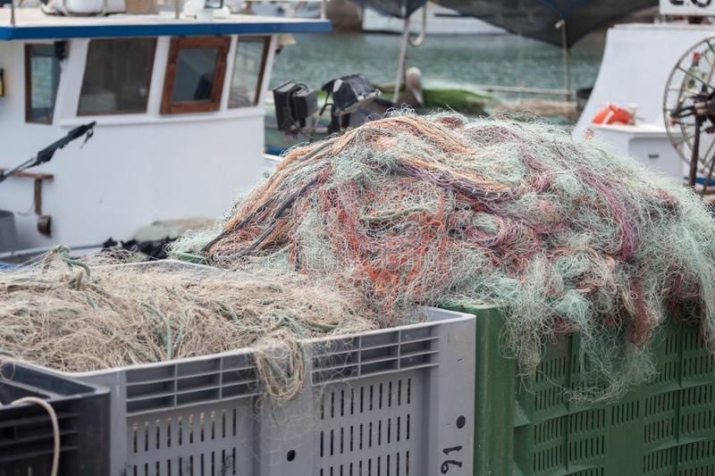 A view of fishing nets inside of the boat stock images