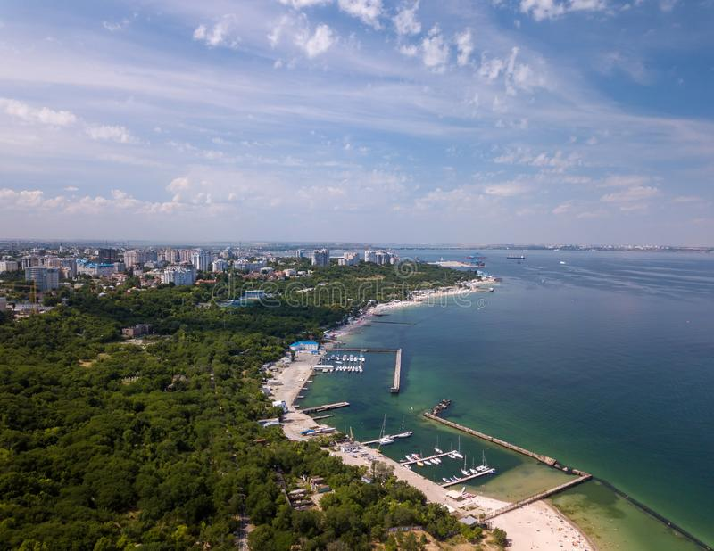 View from a flight altitude on the coast of the city with beaches, boats in the distance tankers and port royalty free stock photos