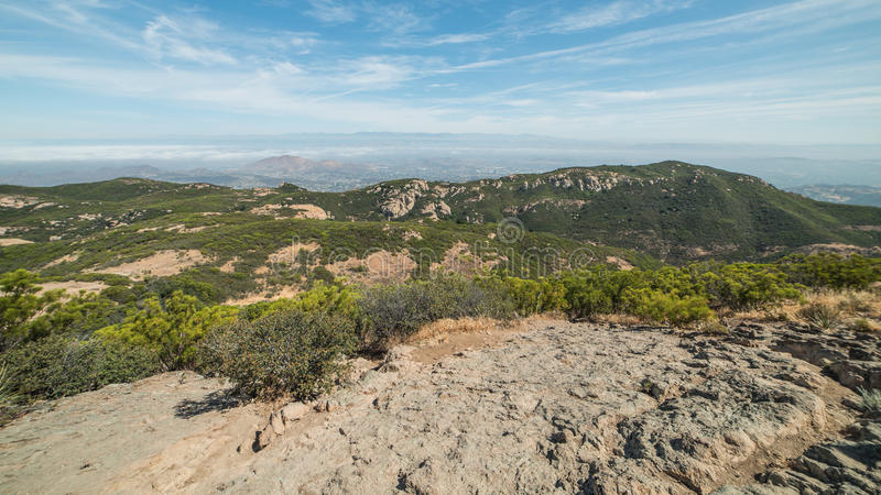View of Foggy Cities from the Summit of Sandstone Peak, Santa Monica Mountains National Recreation Area, California. Sandstone Peak, also known as Mount Allen stock photos