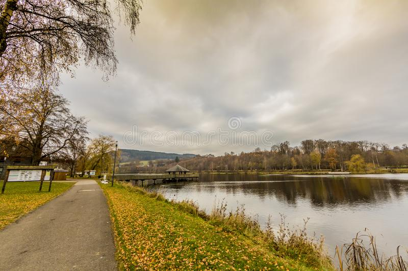View of a footpath next to the Doyards Lake with his gazebo in the middle of the lake stock photos