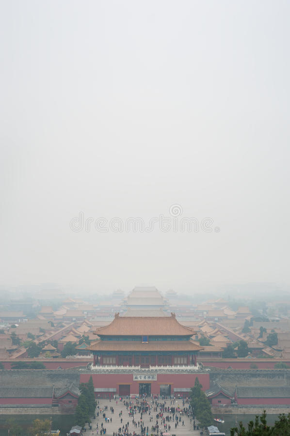 View of the Forbidden City through the air pollution, Beijing. Taken from the top of the hill in Jingshan Park. stock images
