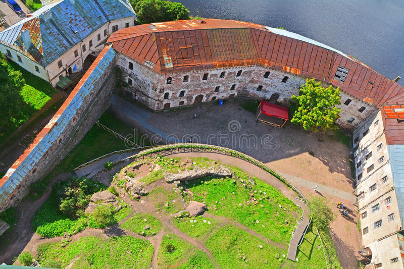 View of forge yard, Prison tower and Southern wall from St. Olav's Tower in Vyborg Castle, Russia. Vyborg castle from height of bird's flight, Leningrad region royalty free stock photos