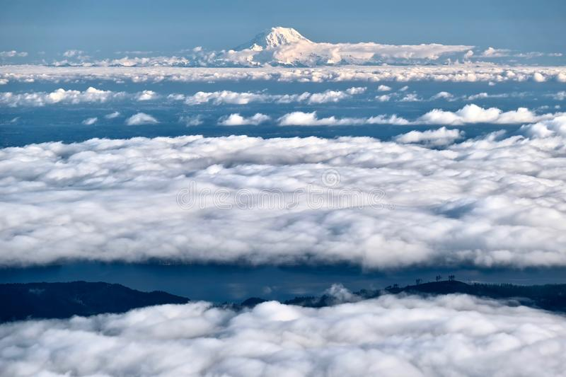 Mount Rainier in clouds and Seattle. royalty free stock images