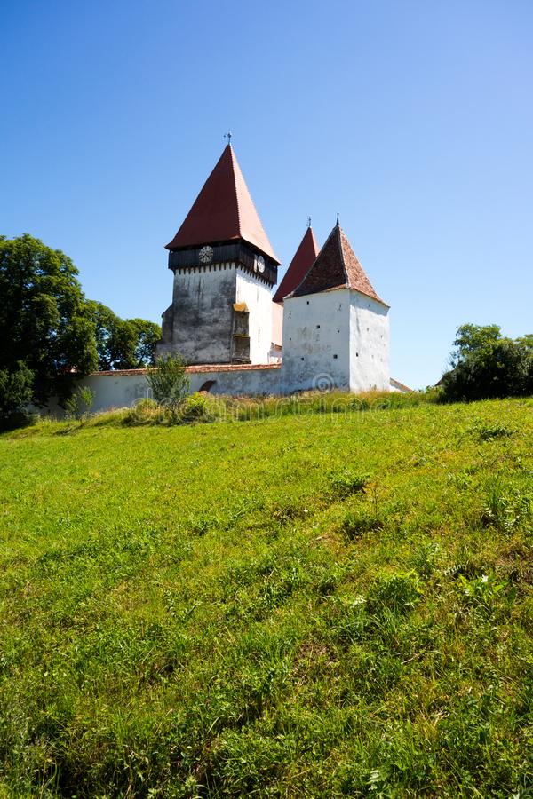 The fortified church from Merghindeal, Sibiu County, Romania. View of the fortified church from Merghindeal, Sibiu County, in Transylvania, Romania royalty free stock images