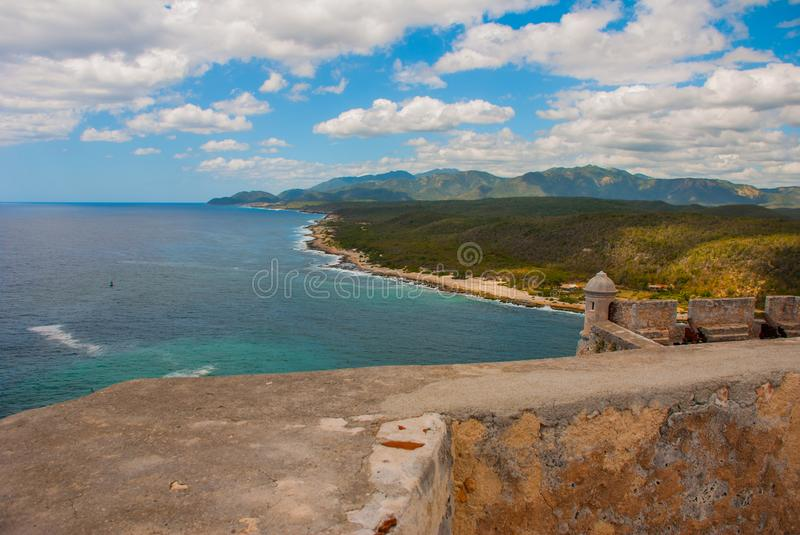 View from fortress of SANTIAGO de CUBA city landscape on Caribbean Sea with ancient fortification located in NORTH AMERICA with be. Auty clouds on blue sky. Cuba stock images