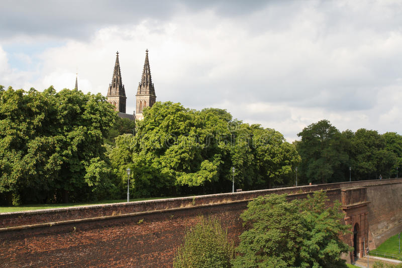 View of the fortress wall and a basilica of St Peter and St Paul. In Vysehrad. Prague, Czech Republic. August 1, 2016 royalty free stock images