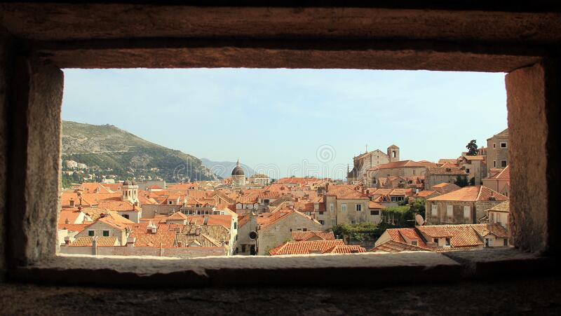 View through the fortress window over the red clay tiled roofs of Dubrovnik, Croatia royalty free stock photography