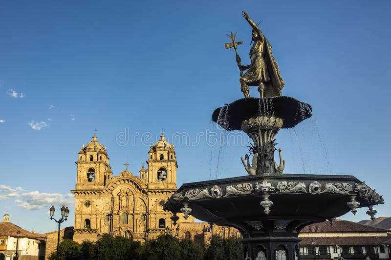 View of the fountain and the Church of the Company of Jesus. Plaza de Armas, Cusco, Peru stock image