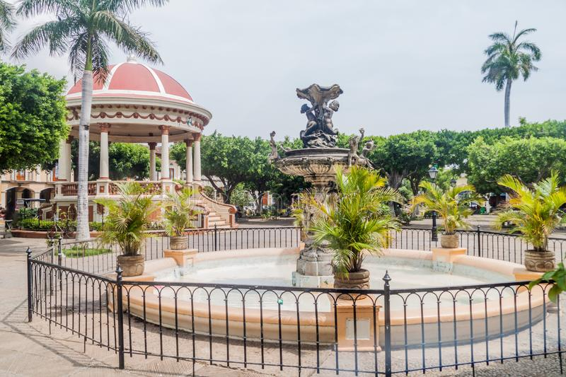 View of a fountain and a gazebo at Parque Central in Granada, Nicarag stock photography