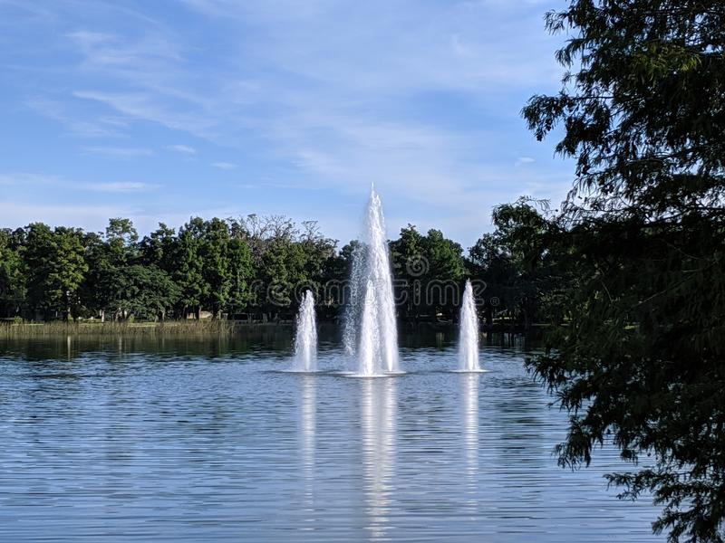 View of the fountain in the middle of the lake royalty free stock photography