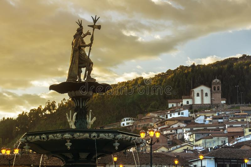 View of the fountain with San Cristobal church in the background. Plaza de Armas, Cusco, Peru stock photography