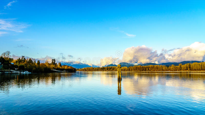View of the Fraser River in British Columbia, Canada. Beautiful view of the Fraser River on a sunny winter afternoon as seen from the historic village of Fort stock photography
