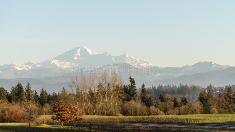 View of the Fraser Valley with Mount Baker in the Background. View of the fraser Valley in British Columbia with the snow capped peak and slopes of Mount Baker royalty free stock images