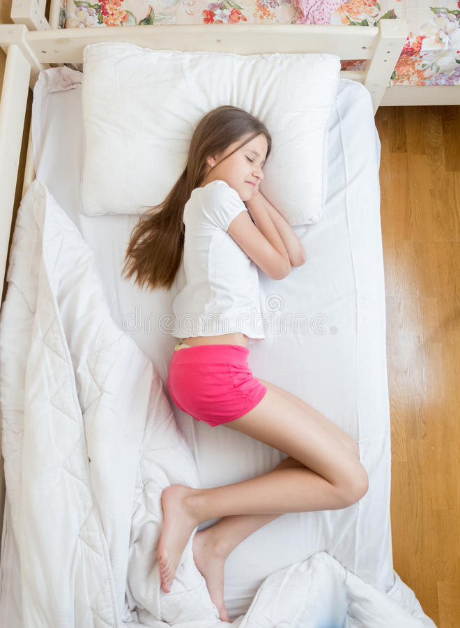 Free View From Above On Brunette Teenage Girls In Pajamas Sleeping On Stock Photography - 76905182