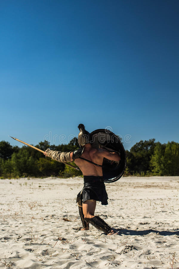 Free View From The Back To The Spartan With A Shield On The Trampled Field Royalty Free Stock Photo - 94764965