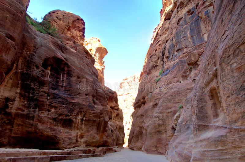 View front from the interior of the Siq leading into the new seventh wonder of the world of Petra in Jordan stock photos