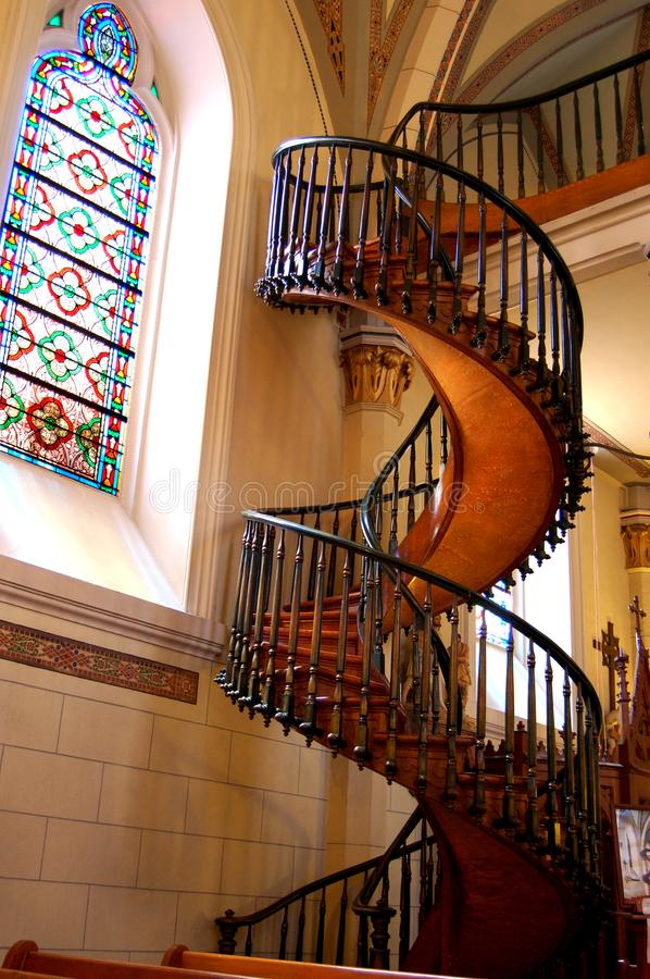 Loretto Chapel Staircase, Santa Fe, New Mexico. View from the front next to stainglass window of Loretto Chapel`s Miraculous Staircase located in Santa Fe, New stock photos