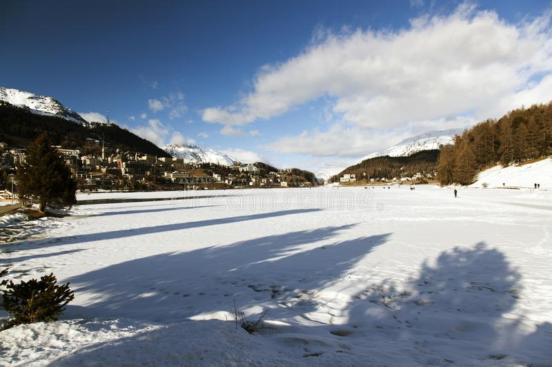 A view of frozen lake and mountains and people in the alps switzerland.  stock photography