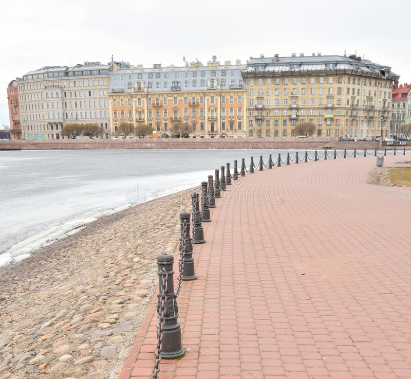 View of Frozen Neva River and Petrograd side. View of Frozen Neva River and Petrograd side in center of St.Petersburg at cloudy winter day, Russia stock images