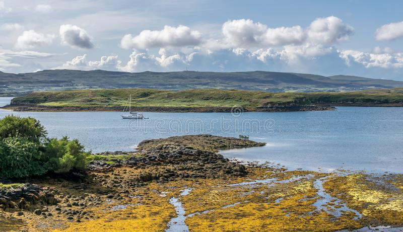 A view of Gairbh Eilein.island with a yacht as seen from dunvegan castle. Streams running into the sea stock photo