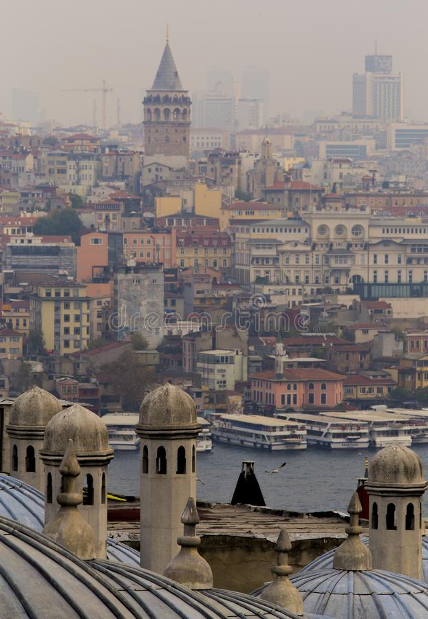 View of Galata from Suleymaniye Mosque with Golden Horn between in low contrast ambient light. royalty free stock photography