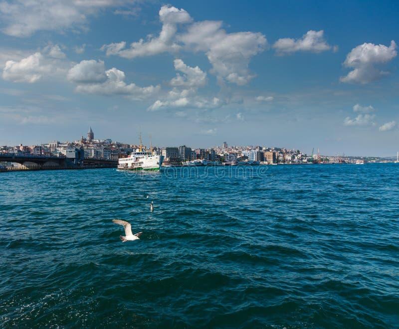 View of Galata Tower and Galata Bridge. Ferries float on Golden Horn waterway.Bosphorus. Istanbul. Turkey royalty free stock image