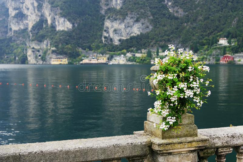 View of the Garda Lake from Via Giancarlo Marone - the Lungolago or Riva del Garda town, in an autumn day. stock photo